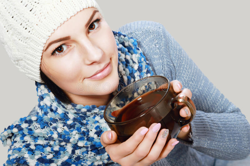 Girl hold hot cup of tea royalty free stock image