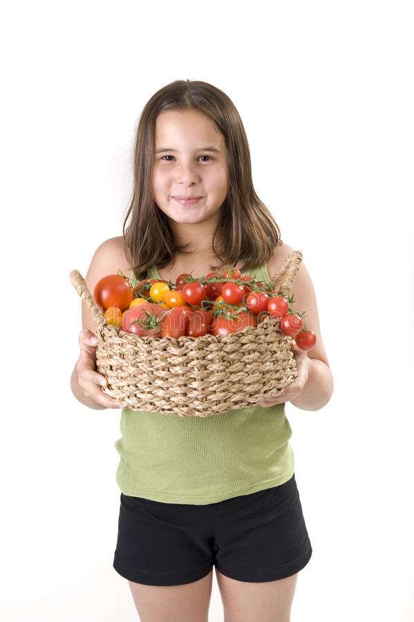 Free Girl Holdin A Basket Of Tomatoes Royalty Free Stock Images - 15500239