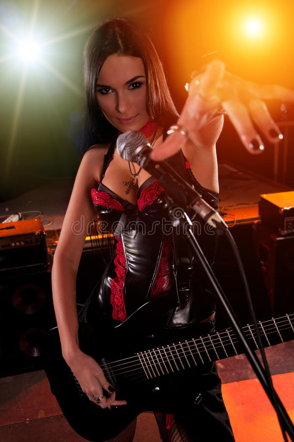 Free Girl Holding A Guitar And Singing On The Stage Stock Images - 17204044