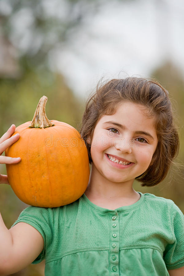 Free Girl Holding A Pumpkin Stock Images - 10518604