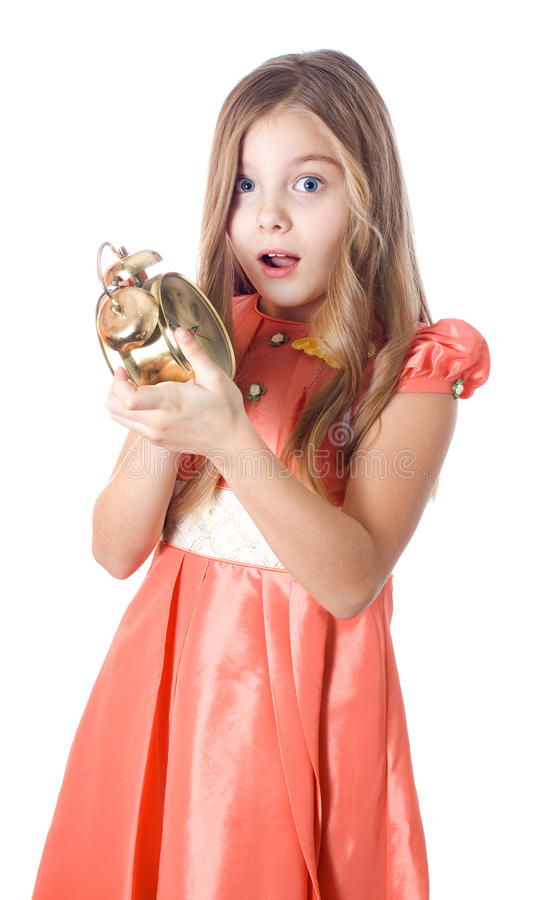 Girl holding alarm clock royalty free stock image