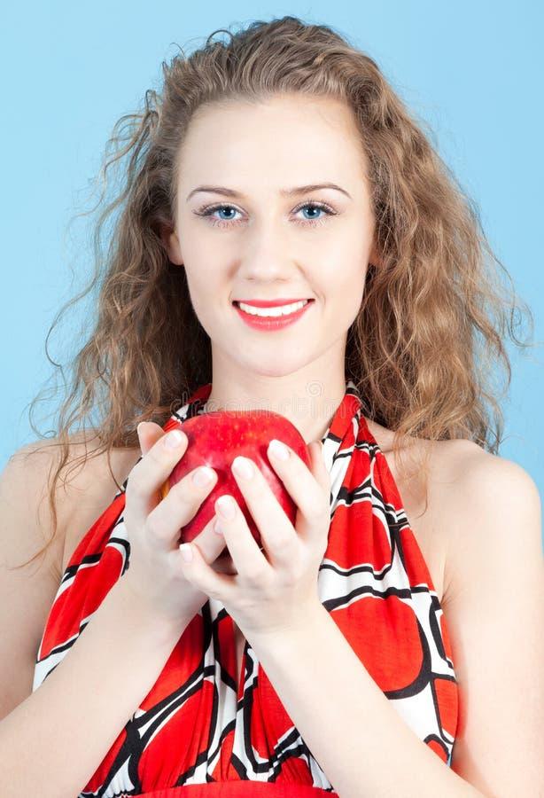 Girl holding an apple royalty free stock photos