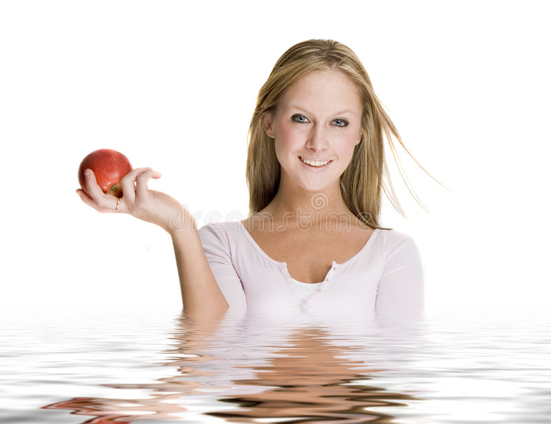 Girl holding an apple stock photos