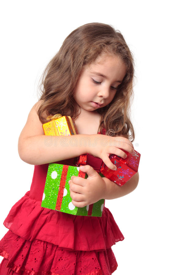 Download Girl Holding An Armful Of Christmas Presents Stock Photo - Image: 10373566
