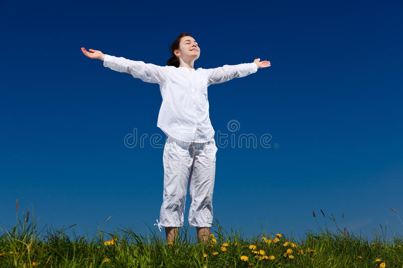 Girl holding arms up royalty free stock photo