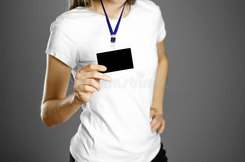 Girl holding a badge. Close up. Isolated background royalty free stock image