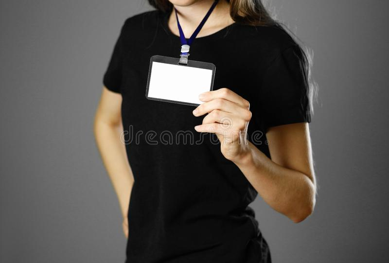 Girl holding a badge. Close up. Isolated background royalty free stock photos