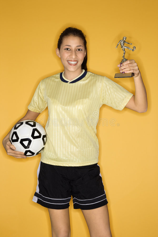 Girl holding ball and trophy. stock images