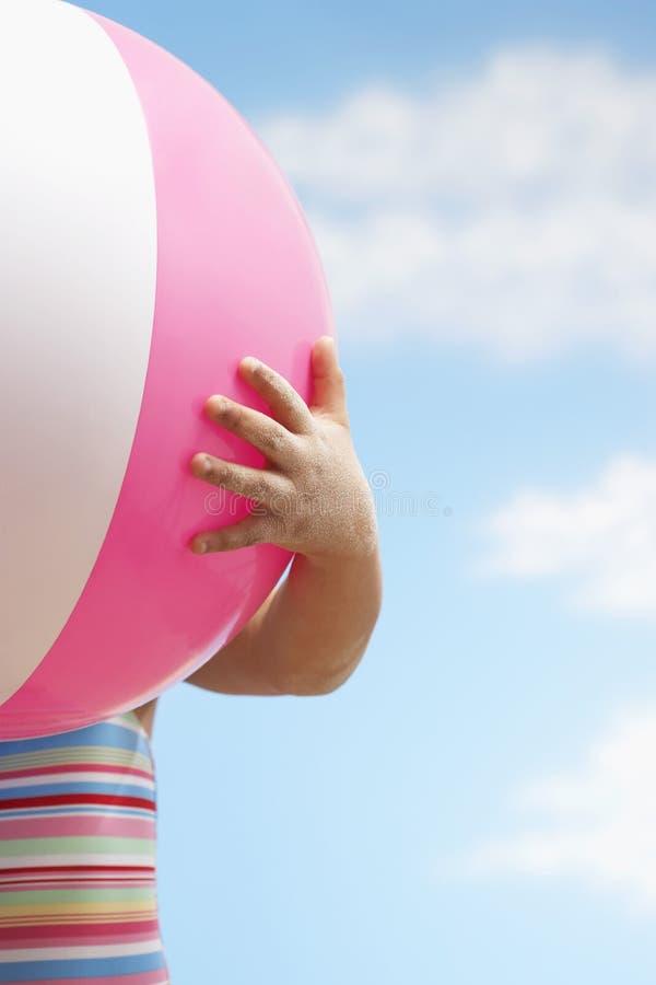 Girl Holding Beach Ball stock photo
