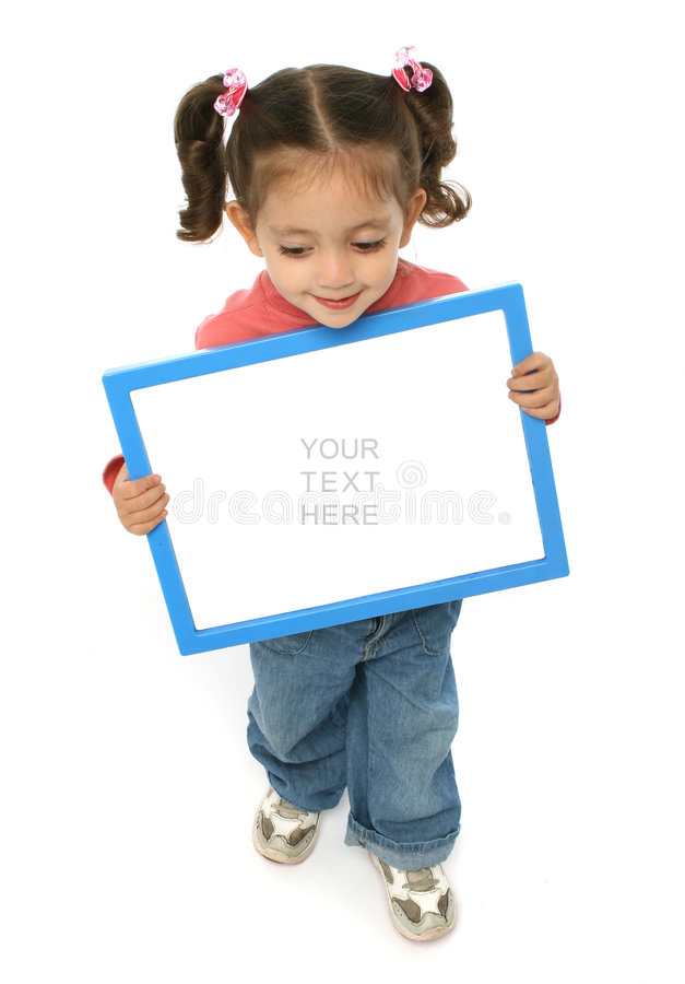 Girl holding a blank sign. Toddler holding an empty sign over a white background stock photography