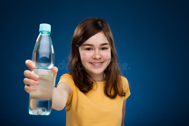 Girl holding bottle of water royalty free stock photo
