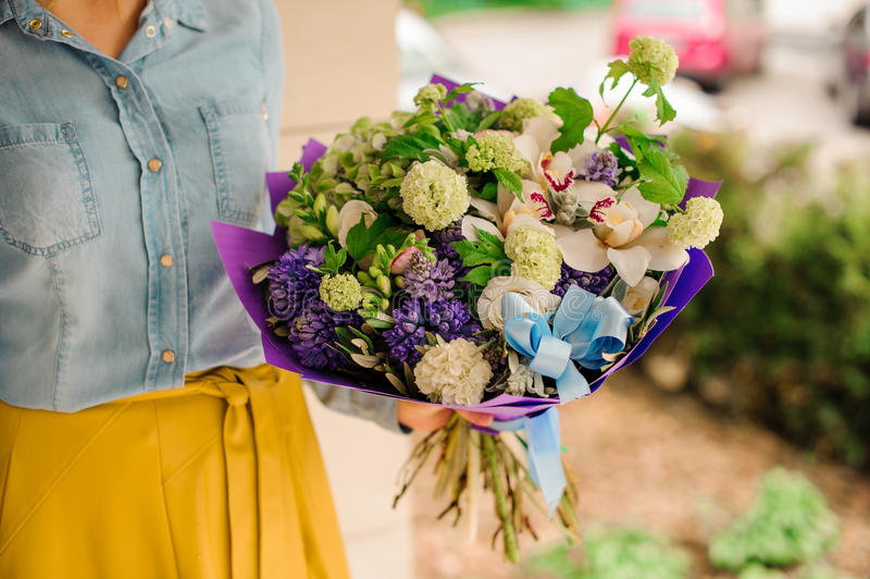 Girl holding a bouquet of flowers royalty free stock image