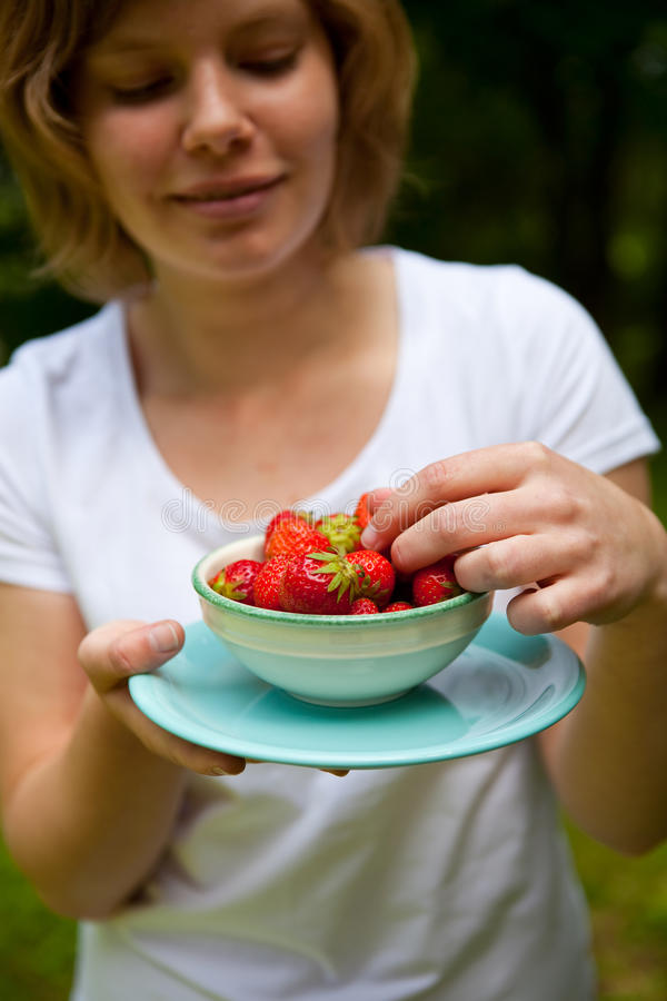 Girl Holding A Bowl Of Strawberries Stock Photos
