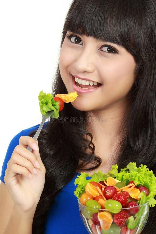 Girl holding bowl of vegetable salad stock image