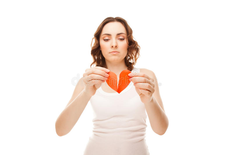 Girl holding broken paper red valentine heart royalty free stock photo