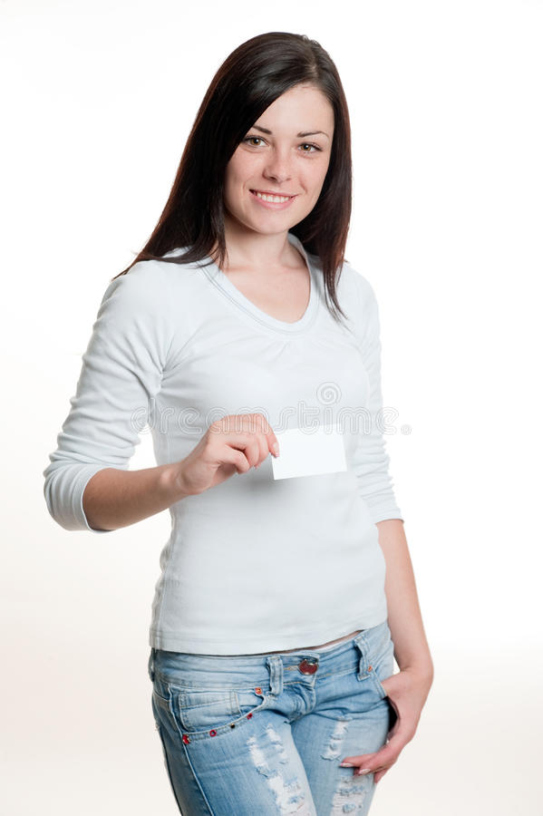 Girl holding business card. Pretty girl holding empty white visiting card royalty free stock image
