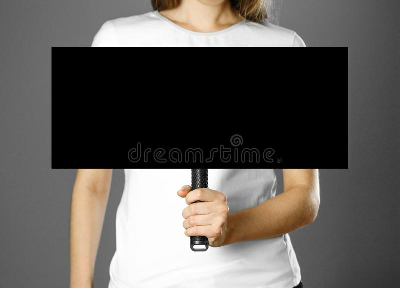 Girl holding a cardboard sign with a handle. Close up. Isolated background royalty free stock image