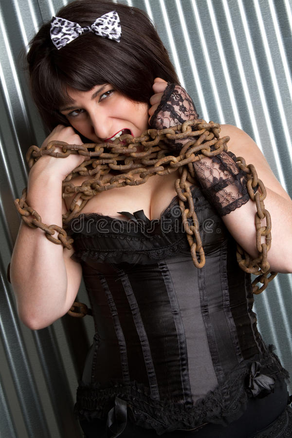 Download Girl Holding Chains Royalty Free Stock Image - Image: 13820796