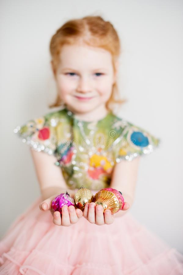 A girl is holding Christmas decorations royalty free stock photo