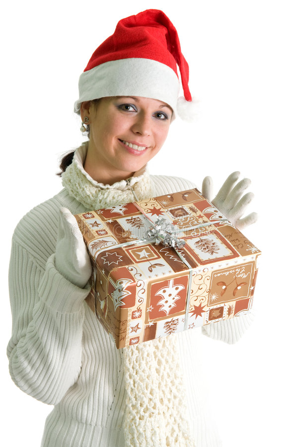Girl holding christmas present. Young girl in santa hat holding Christmas present, isolated over white stock image
