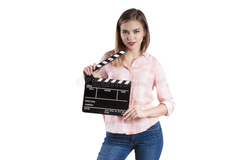 Girl is holding a clapperboard and posing. Isolated on white background. Girl is holding a clapperboard and posing Isolated on white background stock photo