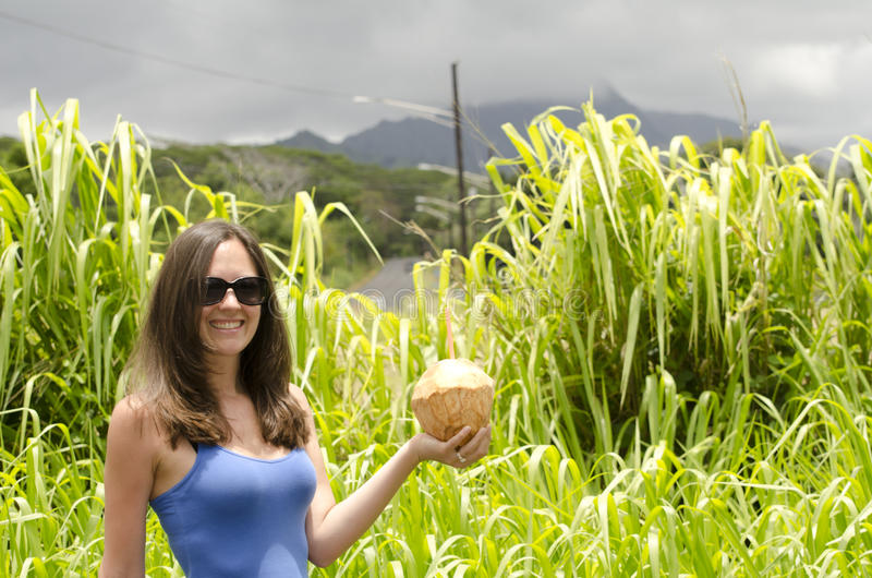 Girl holding a coconut. royalty free stock image