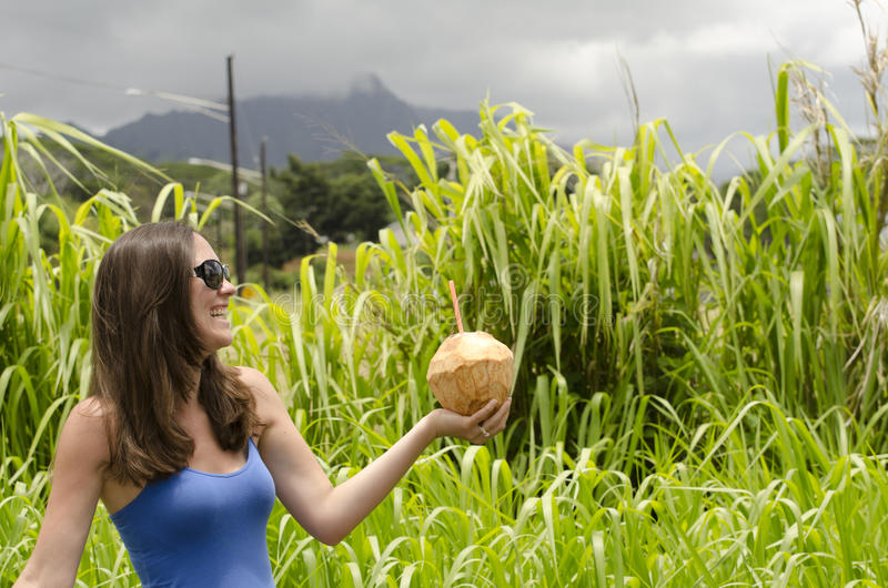 Girl holding a coconut. royalty free stock photo