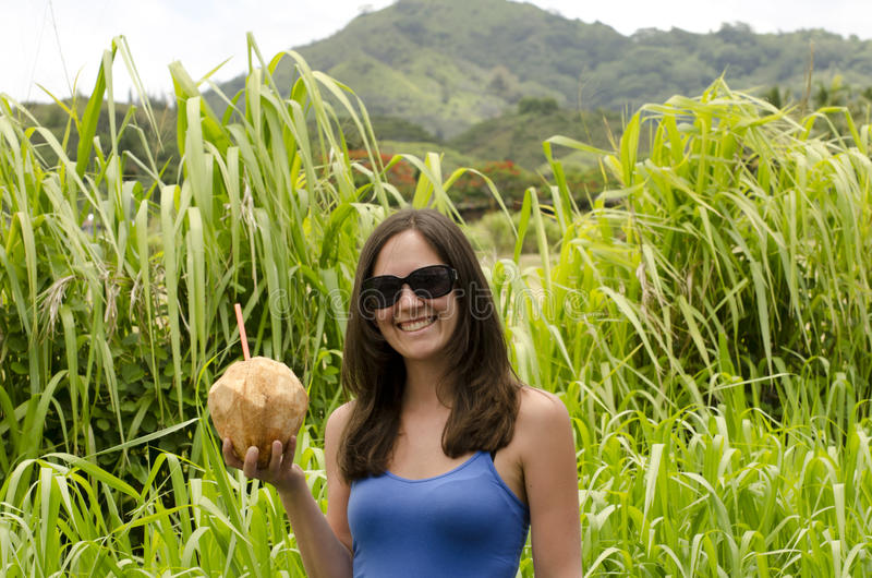 Girl holding a coconut. stock photography