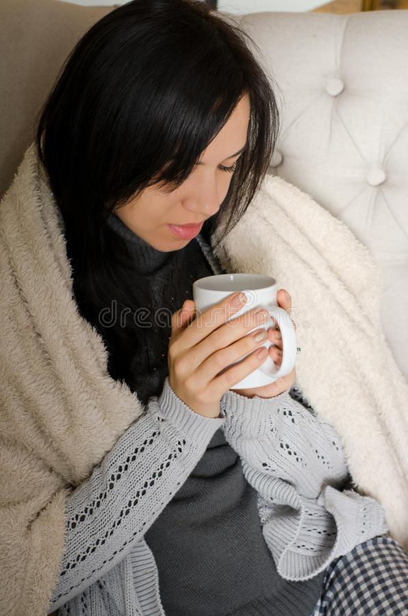 Girl holding a coffee cup stock images