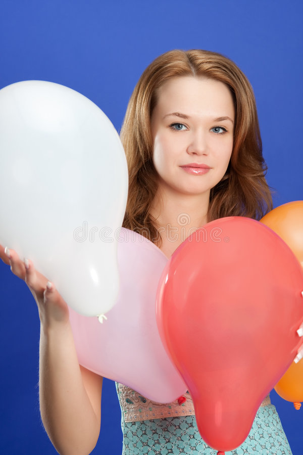 Girl holding color balloons stock images