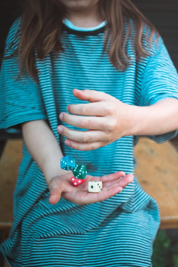 Girl and dice cubes royalty free stock photos