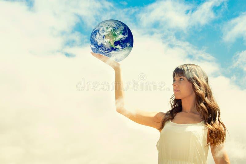 Girl holding earth stock photos