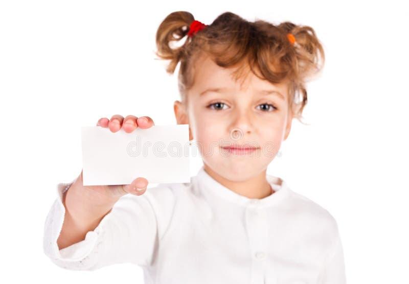 Girl holding empty card stock image