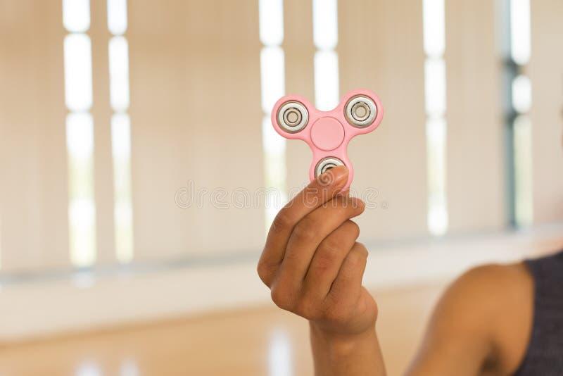 Girl holding a fidget spinner royalty free stock image