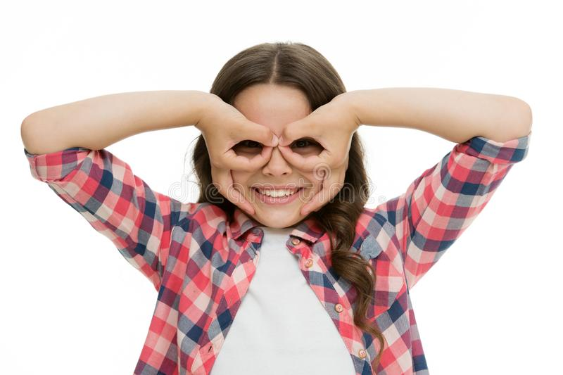 Girl holding fingers near eyes like glasses mask superhero or owl. Play game with mask superhero. Child cheerful mood royalty free stock photography