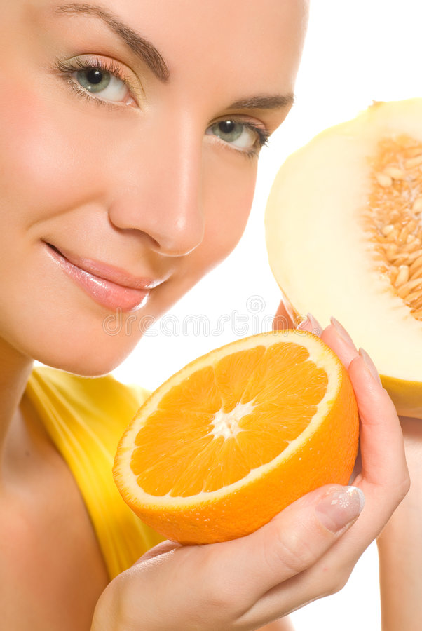 Girl holding fresh fruits. Beautiful girl holding fresh fruits in her hands stock image