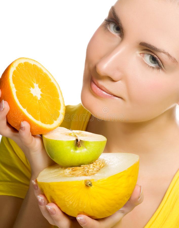 Girl holding fresh fruits. Beautiful girl holding fresh fruits in her hands stock photography