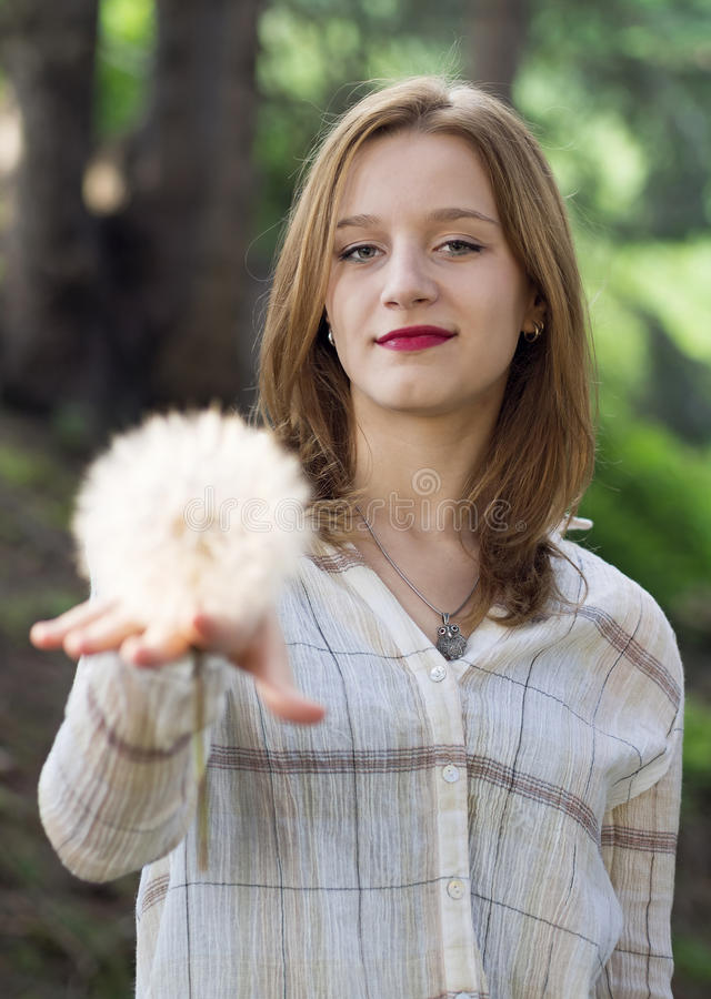 Girl holding a giant dandelion royalty free stock images