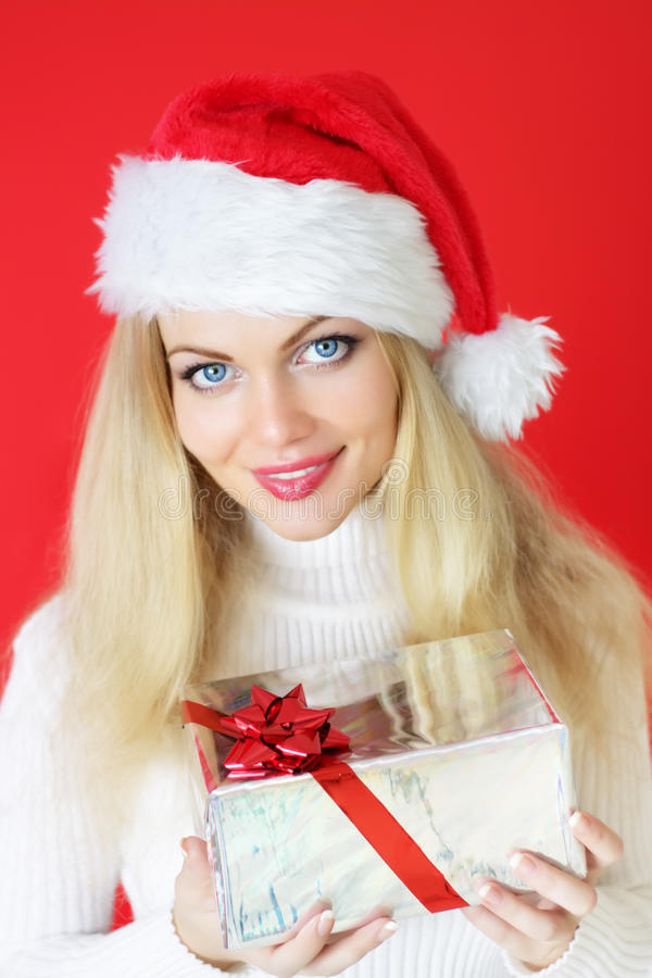Girl holding a gift stock images