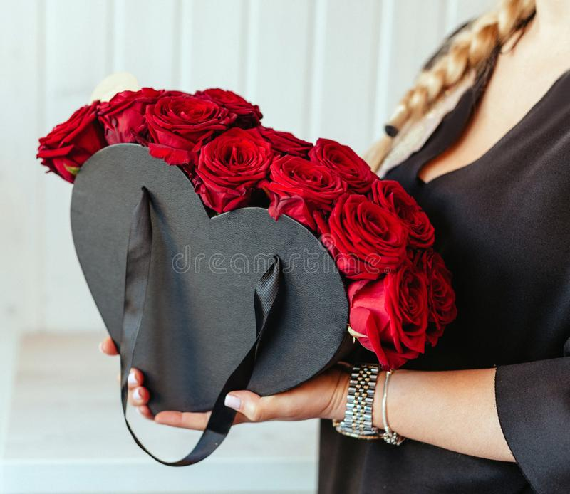 Girl hollding beautiful roses arrangements. royalty free stock images