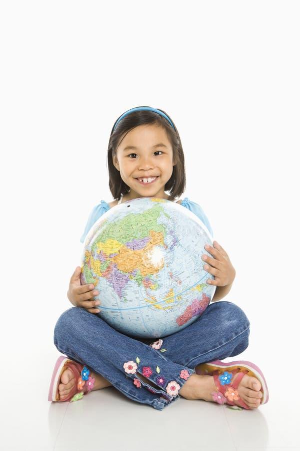 Girl holding globe. stock photos