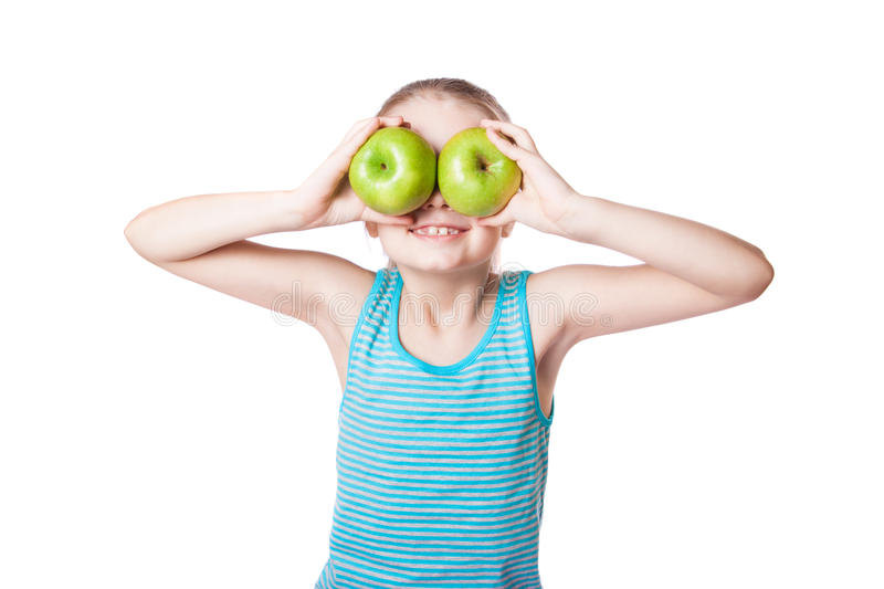 Girl holding a green apple stock photo