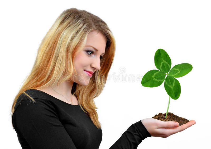 Download Girl Holding In Hand Clover Quarterfoil Stock Photo - Image: 31024924