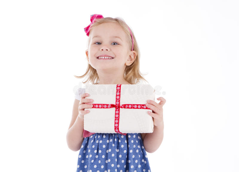 Girl holding a handmade gift packaging. Present royalty free stock image
