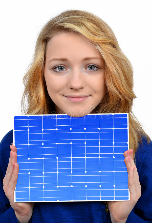 Girl holding in hands solar panel royalty free stock images