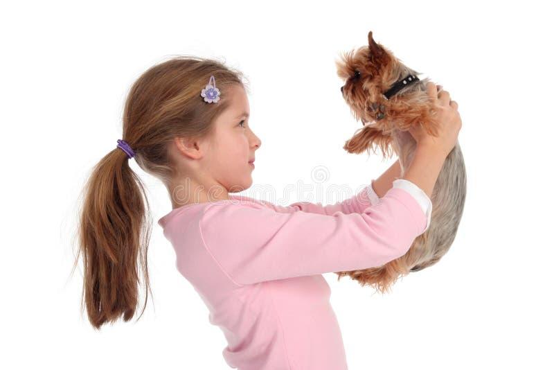 Girl holding her dog stock image