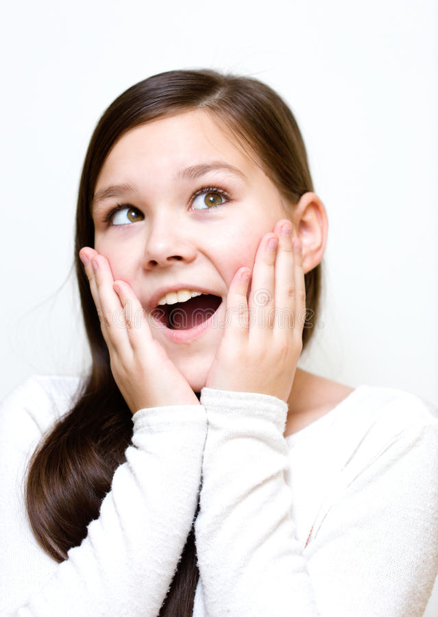Girl is holding her face in astonishment royalty free stock photography