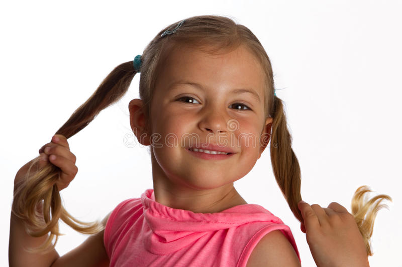 Download Girl Holding Her Pony Tails Stock Photo - Image: 14153092