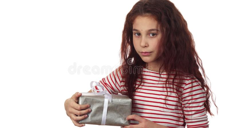A little girl is holding her New Year`s gift in her hands stock image