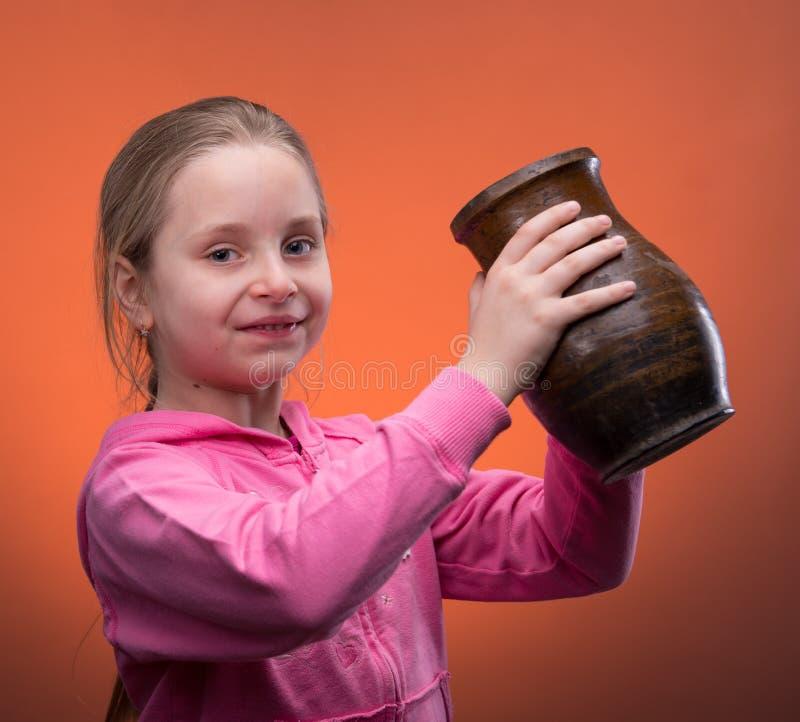 Girl holding a jar